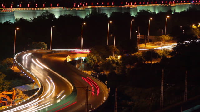 MS T/L HA View of Traffic on street and Xian city wall at night / Xian, Shaanxi, China