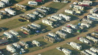 MS AERIAL ZI ZO View of trailers and people tailgating at Talladega Superspeedway / Lincoln, Alabama, United States