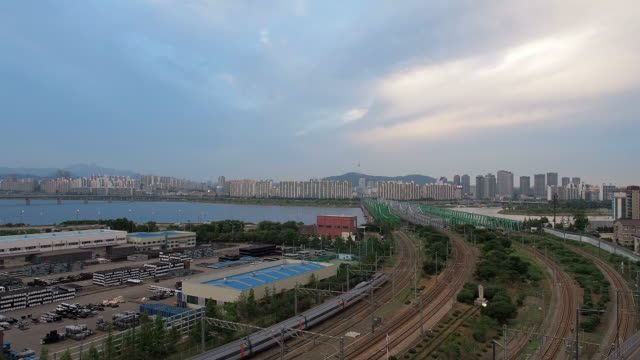 WS T/L View of train passing Hangangcheolgyo(Railroad Bridge) / Seoul, South Korea