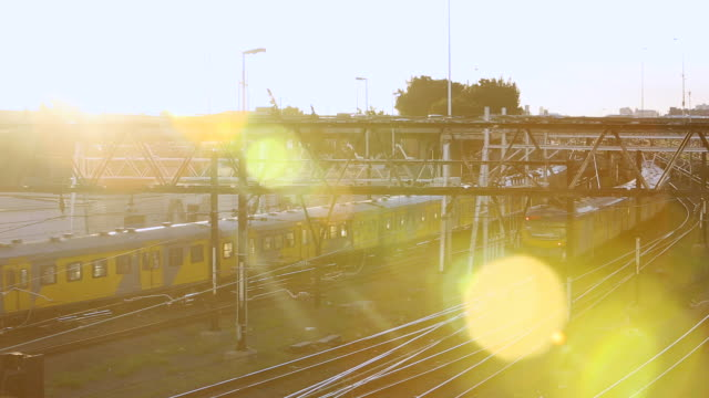 WS View of trains approaching and departing cape town train station / Cape Town, Western Cape, South Africa