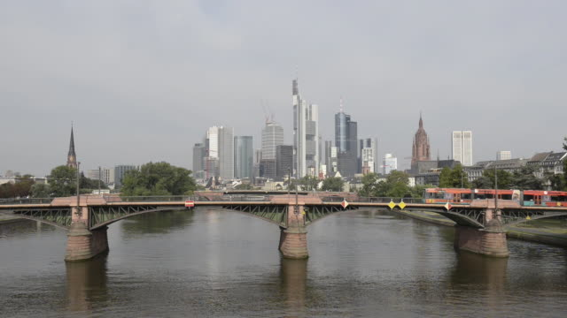 WS View of tram on bridge over river main with skyline and financial district / Frankfurt am Main, Hesse, Germany