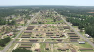 WS AERIAL View of traveling over barracks and campus at military post Camp Shelby / Mississippi, United States