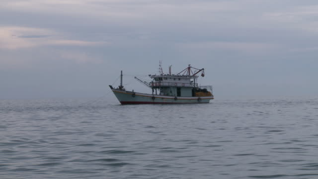 MS View of Trawler boat flowing in ocean / Semporna, Sabah, Malaysia