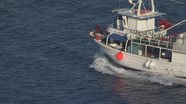 MS AERIAL ZO View of Trawler moving in ocean / Kephaloia, Ionian Islands, Greece