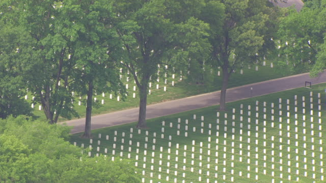 WS AERIAL View of Trees over headstones at Jefferson Barracks Cemetery / St Louis, Missouri, United States