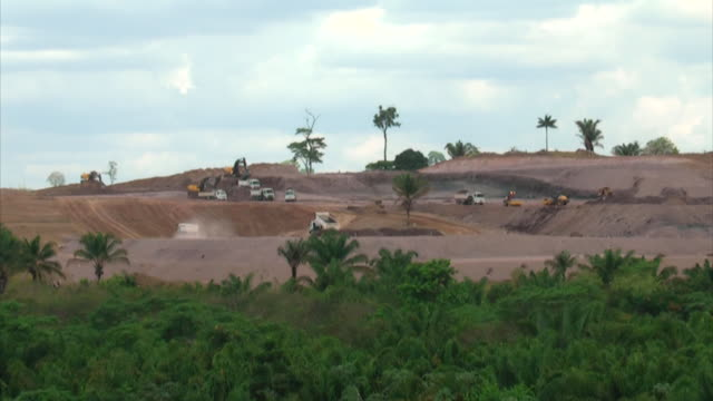 WS T/L View of trucks working at huge construction at amazon / Belo Monte, Para, Brazil