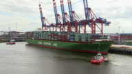 WS T/L View of tug boat pulling container ships at container terminal, harbour of Hamburg / Hamburg, Germany