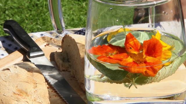 CU View of Vase with herbal water and orange flower / Lenggries, Bavaria, Germany