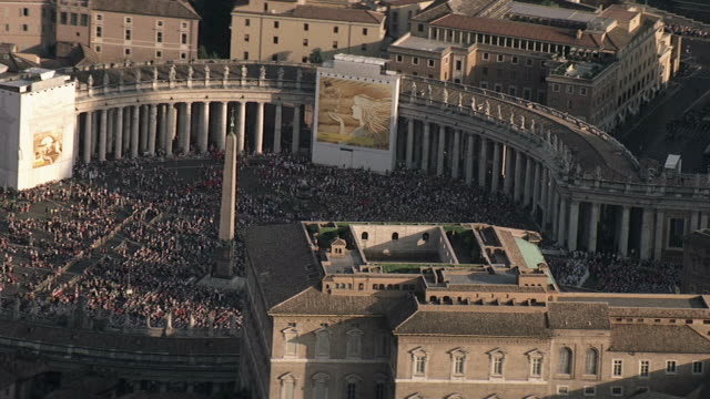 WS AERIAL View of Vatican with crowds in Vatican plaza  / Rome, Italy