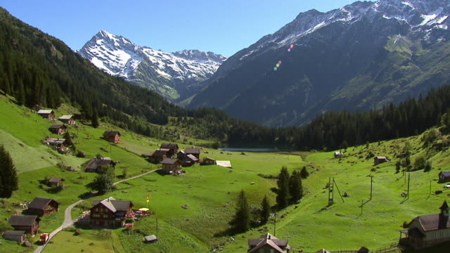 WS AERIAL View of village and Lake Golzeren in Maderaner Valley / Golzeren, Uri, Switzerland