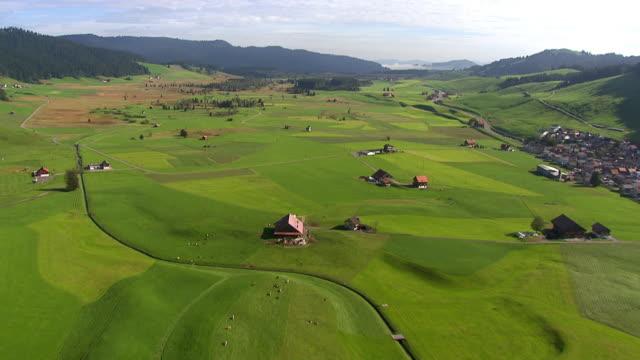 WS AERIAL View of village and moorland landscape / Rothenthurm, Schwyz, Switzerland