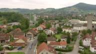 WS AERIAL View of village of Gipf oberfrick with train station, railway and SBB wagon train / Wadenswil, Zurich, Switzerland