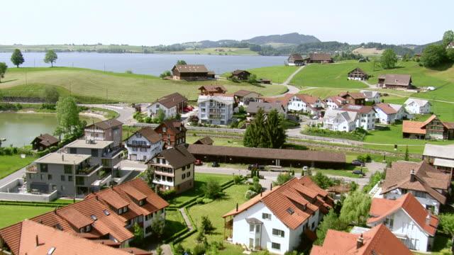 WS AERIAL View of village with lakeside of Lake Sihl / Willerzell, Schwyz, Switzerland