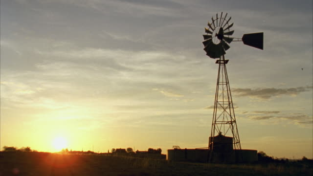 WS View of vintage windmill at sunrise / Marfa, Texas, USA