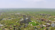WS AERIAL POV View of Washington National Cathedral with cityscape / Washington DC, United States