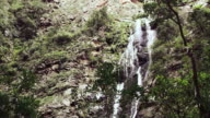 WS View of waterfall pours over rocky cliff / Western Cape, South Africa