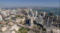 WS POV AERIAL View of waterfront city with skyscrapers / Miami, Florida, USA
