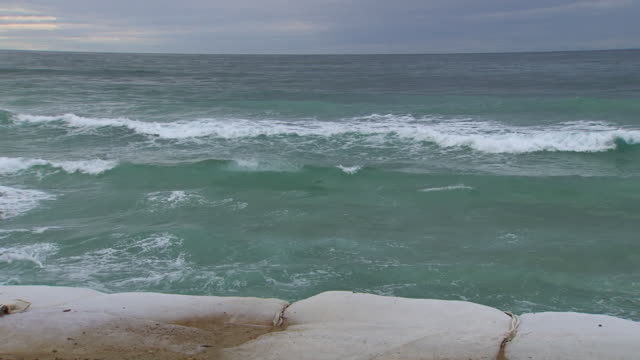 WS PAN View of Waves hitting sandbags / Kingscliff, New South Wales, Australia