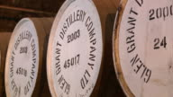 MS View of whisky casks in warehouse / Rothes, Speyside, Scotland