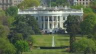 WS ZO AERIAL POV View of White House with city / Washington DC, United States