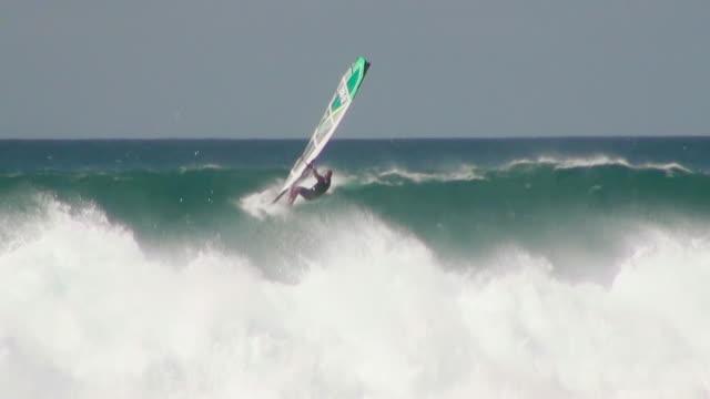 WS TS View of Wind sail surfing on big waves at beach near Santa Maria / Santa Maria, Sal, Cape Verde