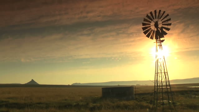 WS LA View of Windmill and open field during sunset, Clarens / Free State, South Africa