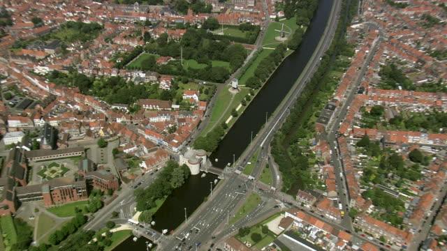 MS AERIAL ZI ZO PAN View of windmills on old city walk in Bruges / Flanders, Belgium