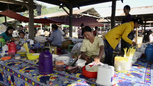 MS View of Woman is cooking at Local Market / Nyaungshwe, Shan State, Myanmar