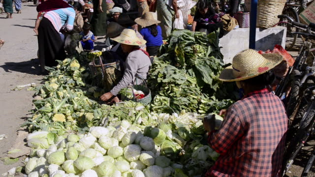 MS View of Woman vegetables seller at Local Market / Nyaungshwe, Shan State, Myanmar