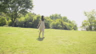 WS TS View of Woman walking over lawn barefoot / Uji, Kyoto, Japan