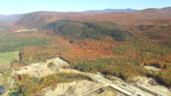 WS AERIAL PAN ZI ZO View of wooded area with autumn color / Vermont, United States