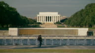 WS TD View of World War II Memorial with water fountains and Lincoln Memorial and text etchings in stone / Washington, District of Columbia, United States