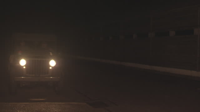 MS View of WW2 American Military Vehicle Arrives at Night / Horsham, West Sussex, United Kingdom