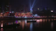 WS ZO View of  Yangtze river with buildings and searchlights of downtown Chongqing city in background / Chongqing, Sichuan Province, China