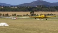 WS TS View of Yellow plane steve takes off in glider / Macarthur, Victoria, Australia