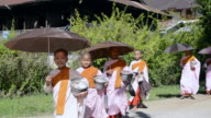 MS View of Young Nuns walking with alms and smiling / Nyaungshwe, Shan State, Myanmar
