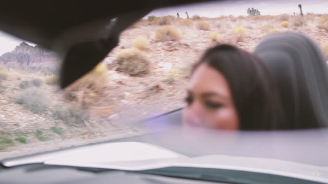 View on female in rear view mirror driving