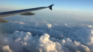 View out of plane window over clouds, some turbulence