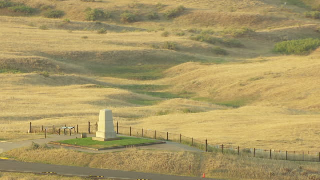 MS AERIAL ZO View over Army Memorial on Last Stand Hill in Little Bighorn and surrounding land / Crow Agency, Montana, United States