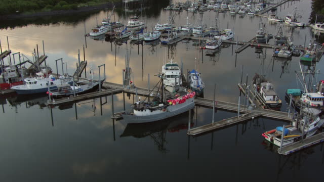 MS AERIAL View over boats docked at St Hermans Harbor / Kodiak, Alaska, United States
