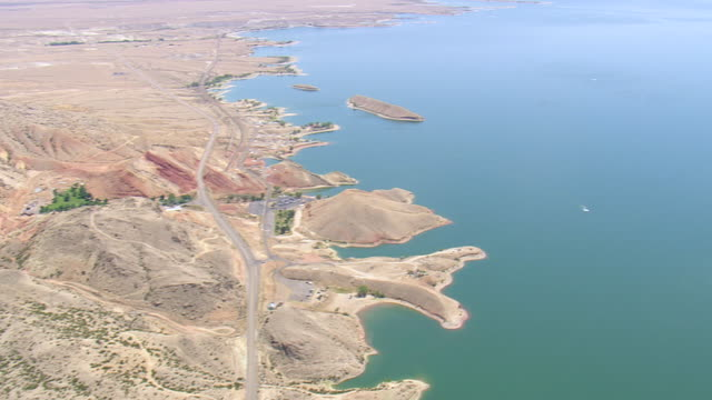 WS AERIAL PAN View over Boysen Dam and road with desert landscape / Wyoming, United States