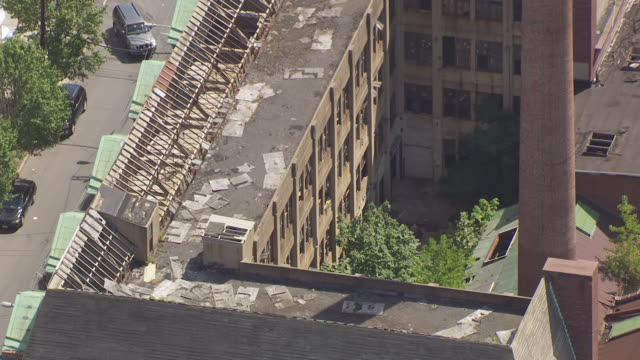 MS AERIAL View over busted windows at old factory / Newark, New Jersey, United States