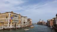 WS HA View over Canal Grande near Accademia, Santa Maria Della Salute with several boats in sailing water / Venice, Veneto, Italy
