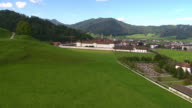 WS AERIAL View over city with Einsiedeln abbey landscape / Einsiedeln, Schwyz, Switzerland