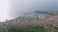 WS AERIAL View over city with harbor along sea coast / Monaco, France