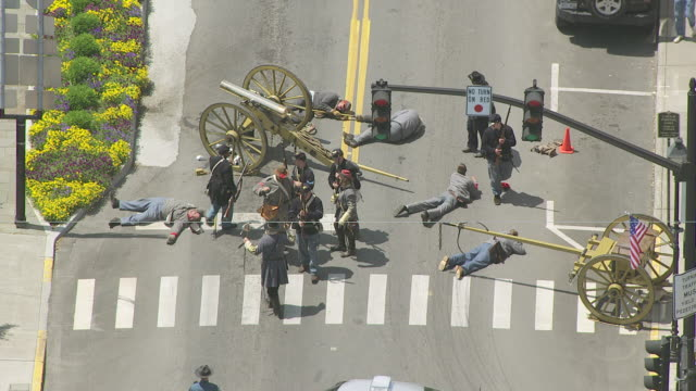 MS AERIAL View over dead soldier at Lewisburg Reenactment on street / Fayetteville, West Virginia, United States