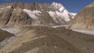 WS AERIAL View over debris covering Unteraar Glacier with huge medial moraines with Summit of Lauteraarhorn / Unteraar Glacier, Bern, Switzerland