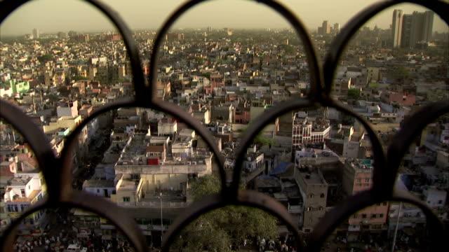 A view over Delhi through metal grating.