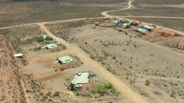 WS AERIAL View over Earthships houses made of natural and recycled materials in Taos County / New Mexico, United States