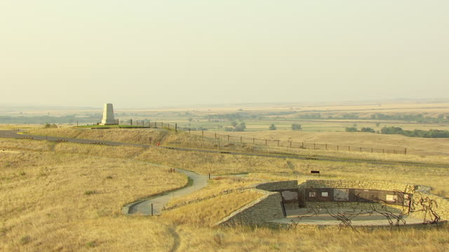 WS AERIAL DS View over field to Last Stand Hill memorial for US Army at Little Bighorn / Crow Agency, Montana, United States